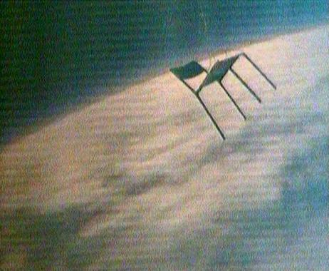 Chair, floating above earth.