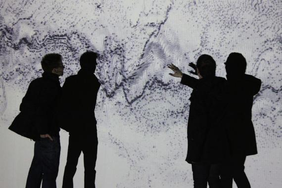 The artists engage with a large scale image of a model of the Antartic Southern Ocean.