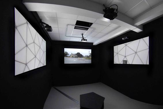 Photographs of RAF Menwith Hill, North Yorkshire projected in a gallery space.