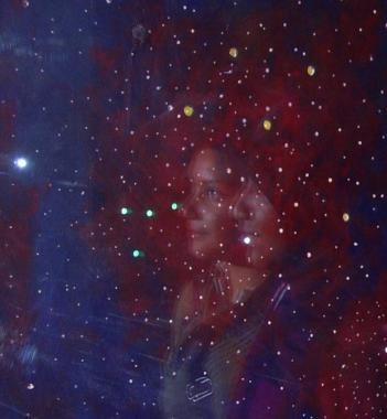 A photograph of an imagined constellation, overlaid with a photograph of pupils from the Mulberry School.