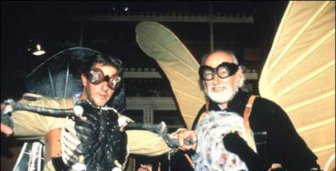 Two men dressed in opulent insect costumes as butterfly and beetle Professor Richard Vane-Wright and Jan Fabre,