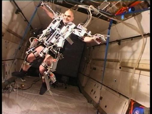 Antnez wears an exoskeletal body interface whilst floating in zero gravity.
