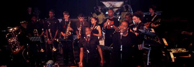 Near Earth participants sing with Jerry Dammers Spatial AKA Orchestra, 2006