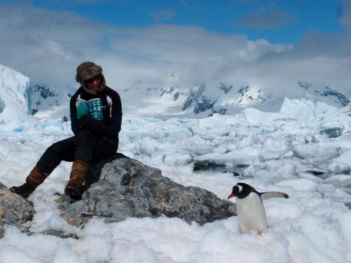 Clare Thorpe reading Ice Lab book, Antarctica 2013