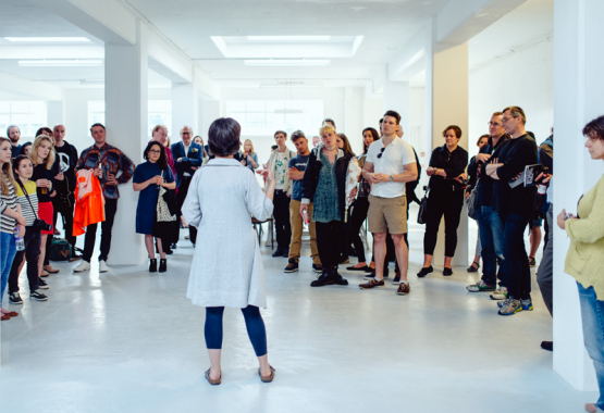 Ele Carpenter introducing the Material Nuclear Culture exhibition, photo Dom Moore 2016